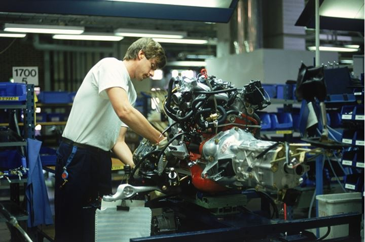 Man working on engine assembly line at Volvo Torslanda Plant near Gothenburg, Sweden