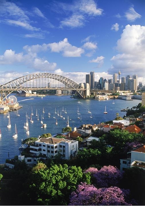 Sydney Harbour Bridge and city skyline from above Lavender Bay in North Sydney