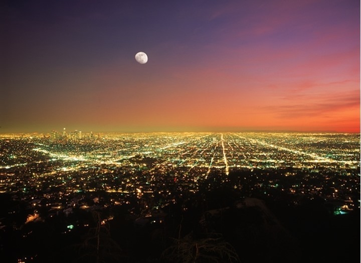 Los Angeles urban sprawl  under rising moon at dusk from Griffith Park Observatory