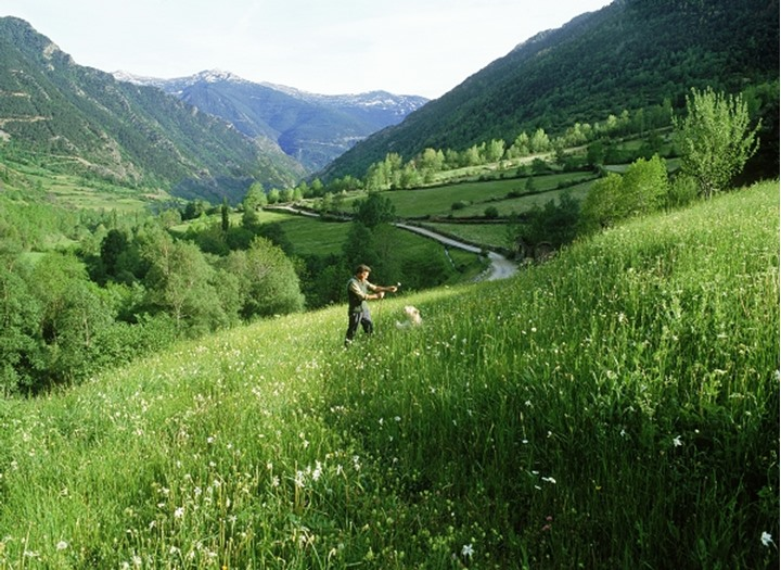 Sheep herdsman with dog at village of Areu in Spanish Pyrenees near Andorra
