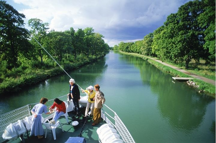 Toursits traveling across Sweden by luxery passenger boat on the Gota Canal between Stockholm and Gothenburg