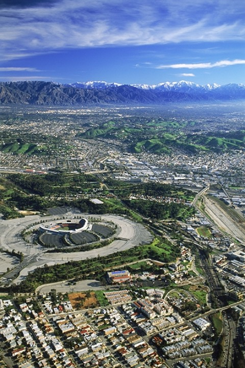 Aerial view of Downtown Los Angeles with snow covered San Gabriel Mountains and Dodger Stadium
