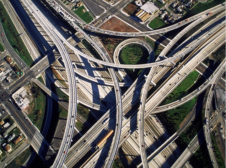 Aerial view of freeway interchange in Los Angeles looking like cemented spagetti