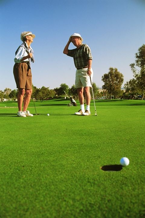 Couple in their 70s playing golf in Palm Springs California