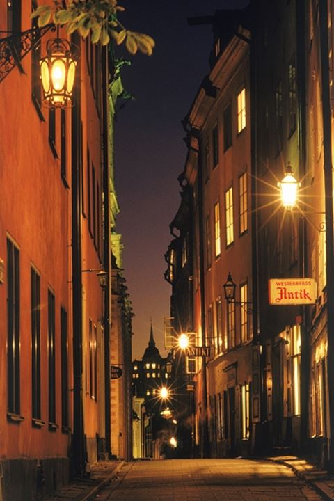Lamplights along cobblestone streets in the Old Town of Stockholm at night