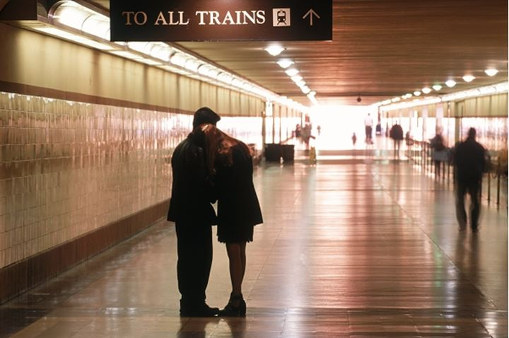 Couple saying goodbye in hallway to departing trains at Union Station in Los Angeles