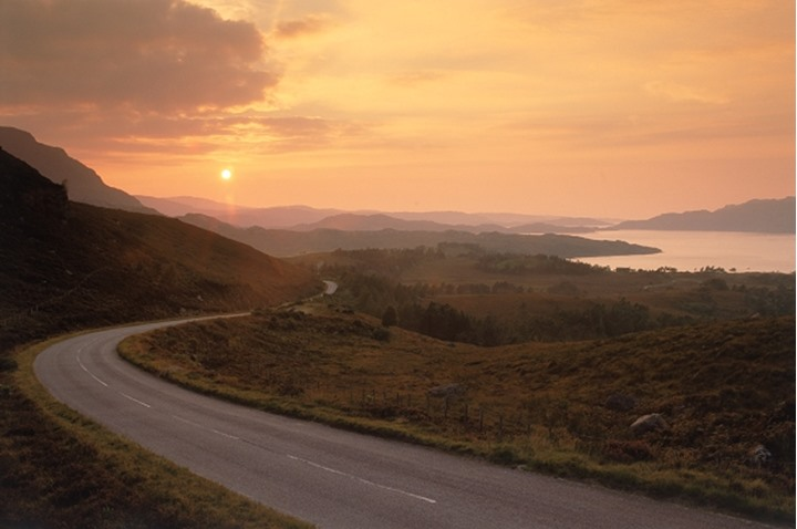 Highway winding along Upper Loch Torridon on the West Coast of Scotland at sunset