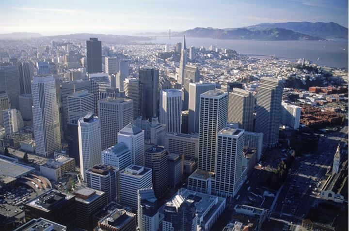 Aerial view of Trans America Tower in financial district with Golden Gate Bridge beyond San Francisco