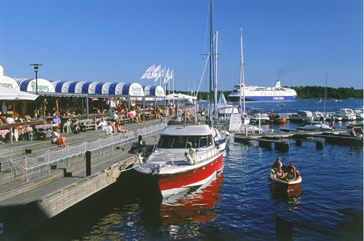 Boats and harbor restaurants at Aker Pier in Oslo, Norway in summer