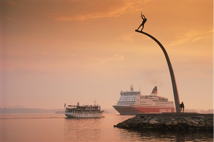 Viking Line passenger ferryboat to Finland passing Nackastrand and Carl Milles statue near Stockholm at sunrise