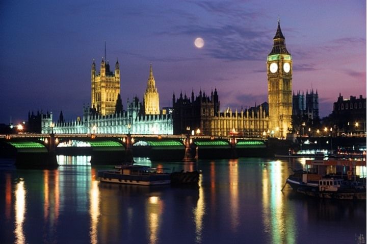 Big Ben and Westminster Bridge and full moon over River Thames at night