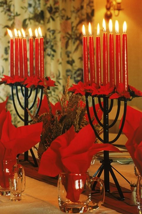Red candles help brighten Christmas holidays