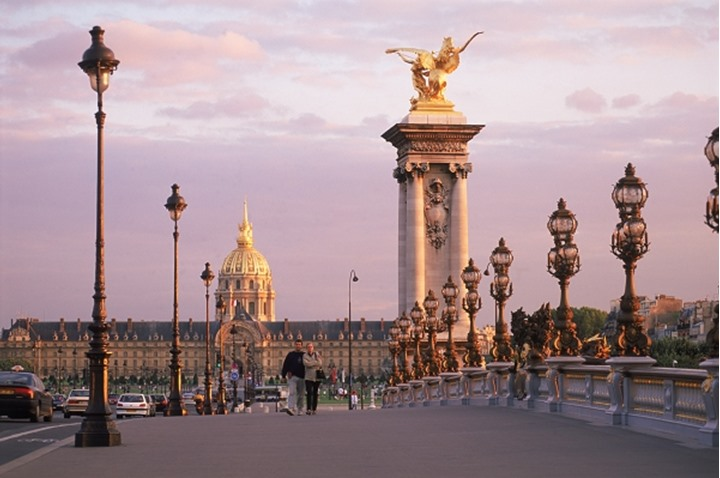 Pont Alexandre III and Hotel des Invalides at sunset in Paris