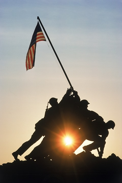 US Marine Corps War Memorial silhouetted in Arlington National Cemetery at sunrise