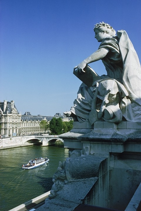 Sculpture along roof of Museum D'Orsay above the River Seine in Paris