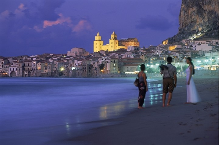 Duomo Cathedral above village of Cefalu on Mediterranean in Sicily