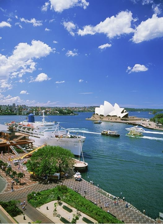 Passenger ships and ferryboats at the Sydney Harbor Quay with Opera House