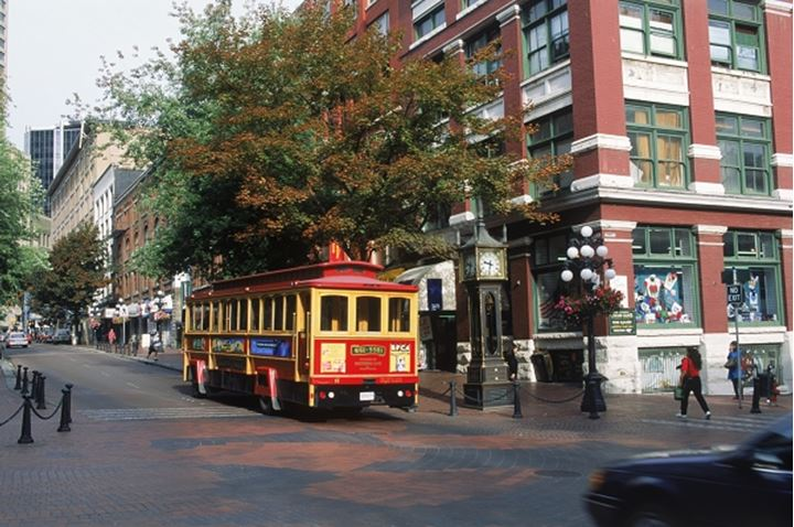Street car passing shops and restaurants in downtown Vancouver, British Columbia, Canada