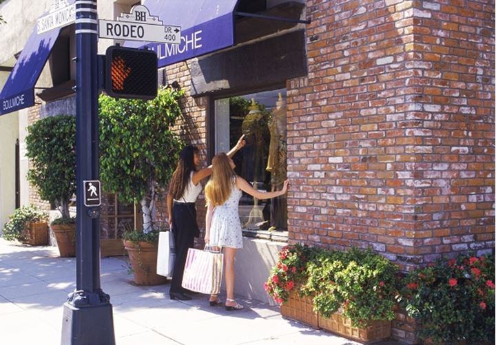 Two women shopping along Rodeo Drive in Beverly Hills California