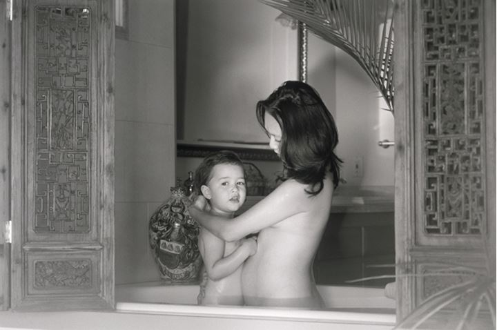 Asian mother and child taking bath together at home