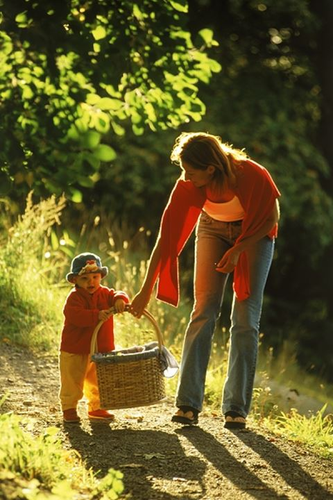 Mother and daughter on pathway with picnic basket