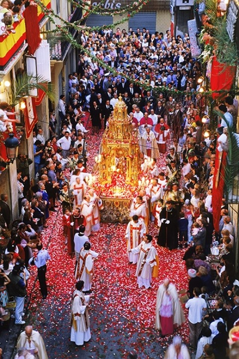 Corpus Christi celebrations with confetti falling on streets of Valencia, Spain
