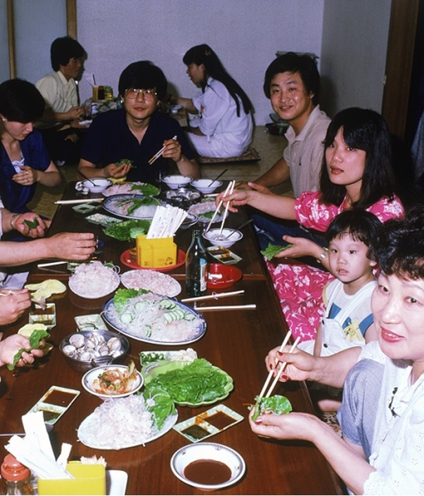 Korean families eating meal in seafood restaurant in South Korea