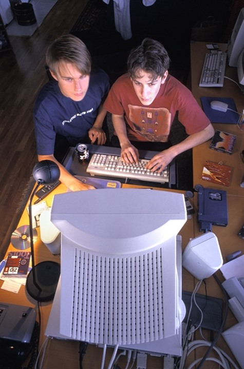 TWO BOYS PLAYING COMPUTER GAMES