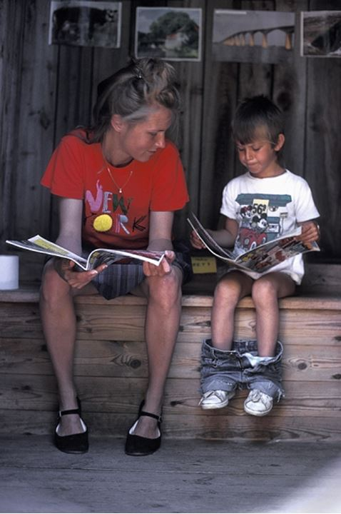 MOTHER AND SON READING COMIC BOOKS