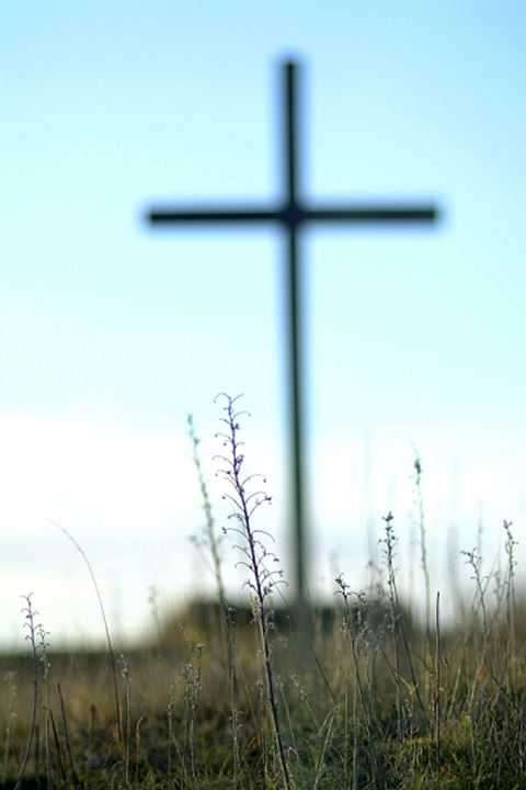 Cross with grass in foreground