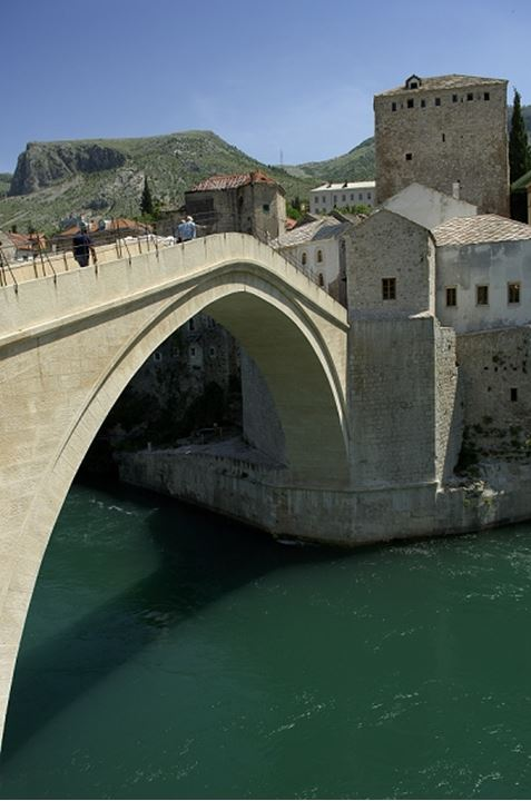 An arched bridge over a river at Bosnia, Mostar