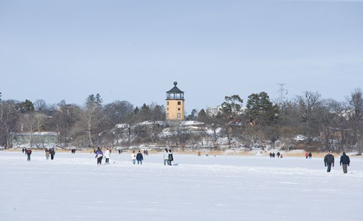 WINTER IN HAGA PARK HAGAPARKEN PEOPLE WALKING ON ICE OF FROZEN LAKE BRUNNSVIKEN