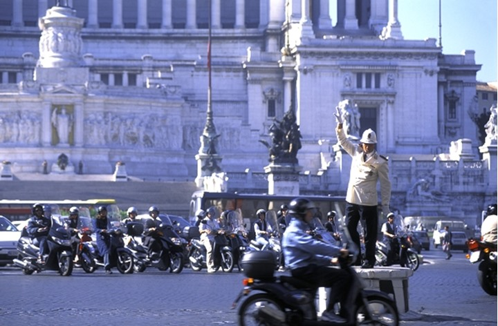 ITALY ROME PIAZZA VENEZIA TRAFFIC POLICE AND ROME CHAOTIC TRAFFIC