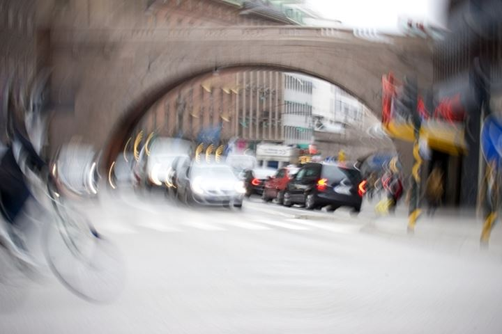 Blurry view of traffic moving by the bridge