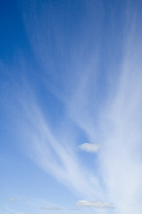 Altostratus clouds formation in azure sky