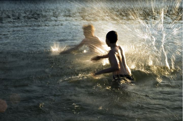 Two boys playing in the water