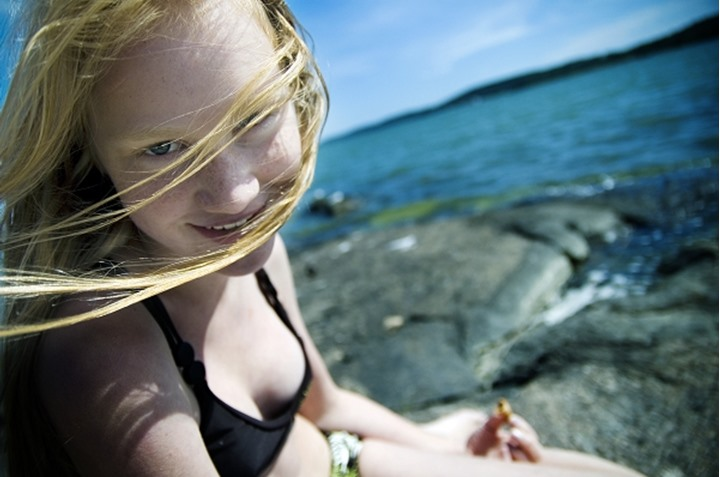 A smiling girl on a holiday by the sea, Sweden