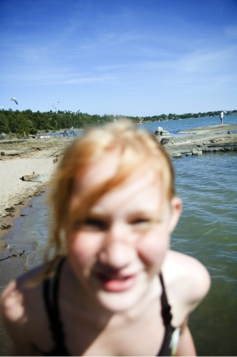 A teenage girl on holiday by the sea, Sweden