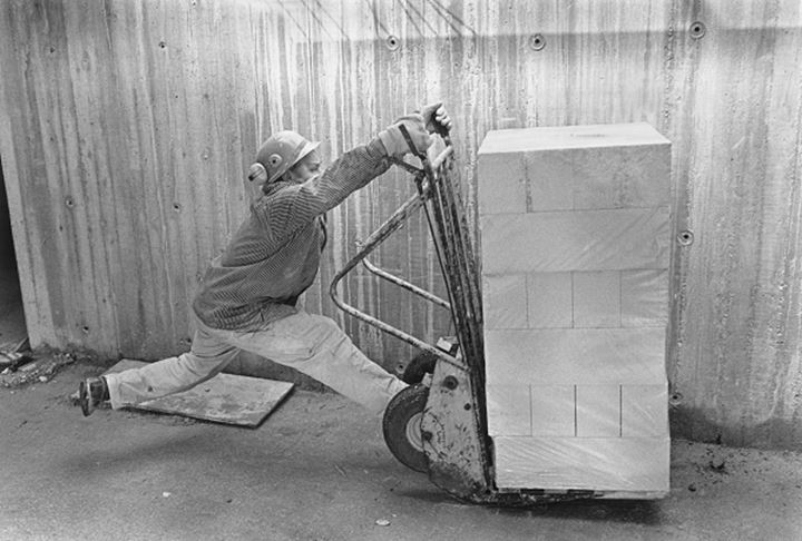 A person loading carriage on the cargo cart