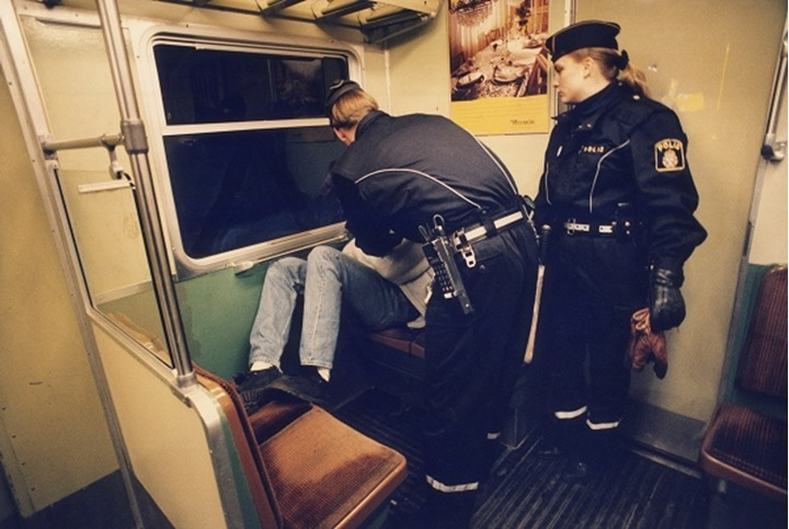 Police searching a person in the train at Stockholm, Sweden