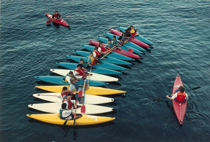 Canoes in a row at the starting of a racing event