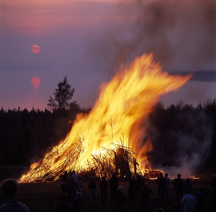 Fire on the beach at sunset, Sweden