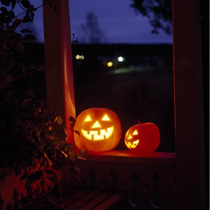 Carved pumpkins with candles in them, Halloween