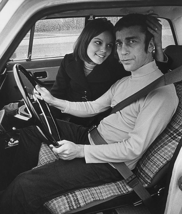 A couple in a car in the 1970's Volvo 164
