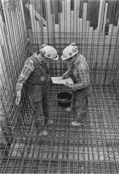 Two men working at a construction site