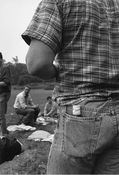 Rear view of a man with a wine bottle in back pocket