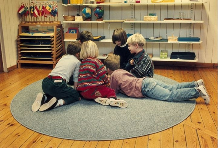 Small group of children playing indoors