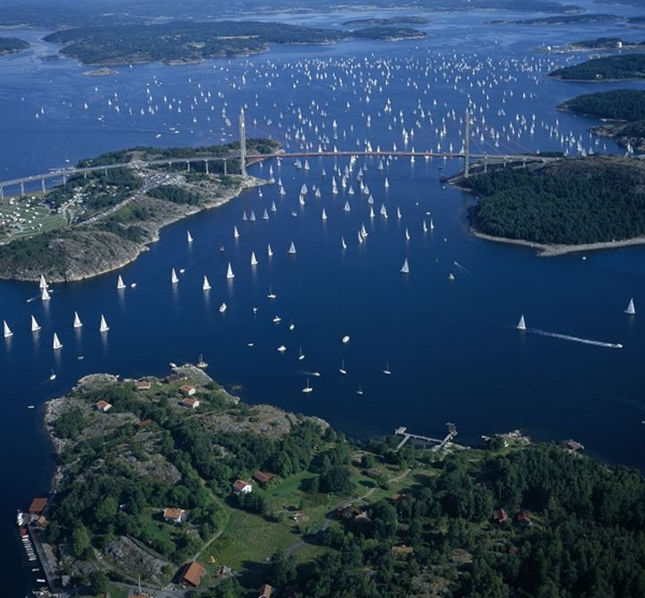"Air Photo of a sailing race namned ""Tjorn runt ""with the Tjorn bridge in Bohuslan, Sweden."