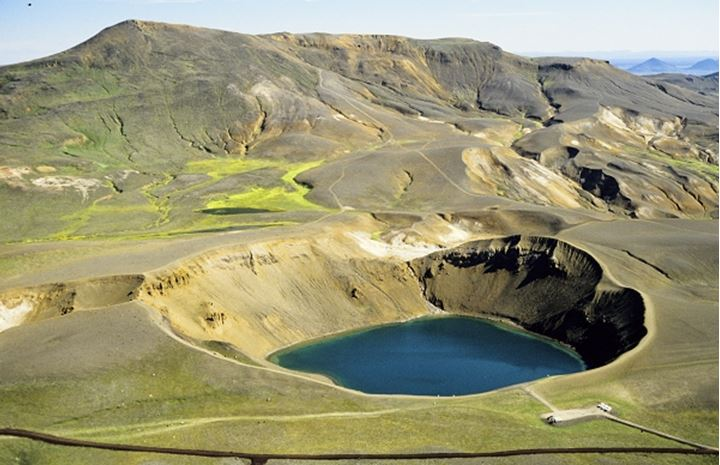 Iceland, Scenic view of pond with mountain