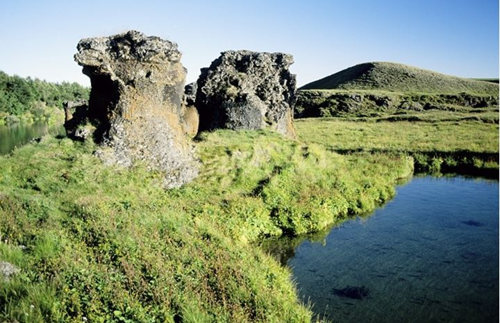 Iceland, Rocky boulders by the pond